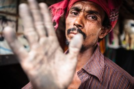 Portrait of a young man, Karwan Bazar slum, Dhaka, Bangladesh, Indian Sub-Continent, Asia