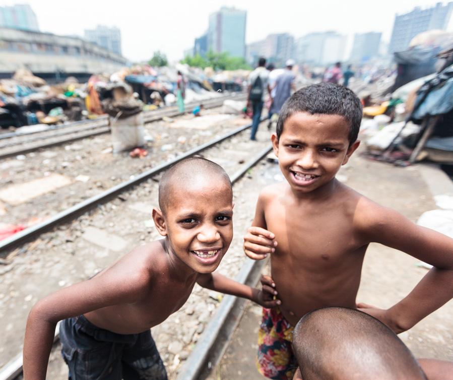 Bangladeshi kids playing and posing in front of the camera at Karwan slum, Dhaka, Bangladesh, Indian Sub-Continent, Asia
