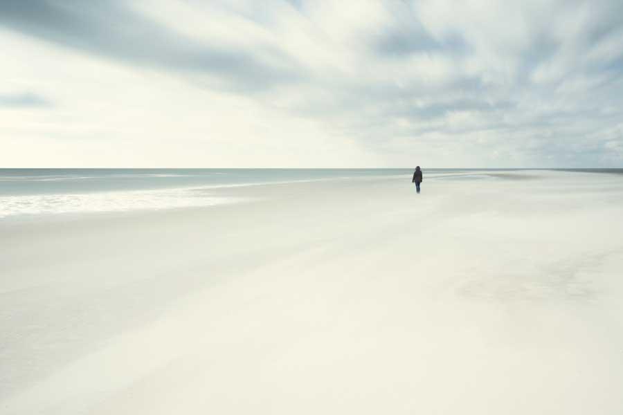 women standing on ocean