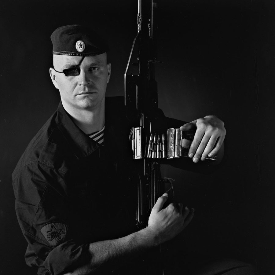 Dmitri Beliakov - Andrei Boldyrev, Captain. Interior Ministry Spetsnaz. Veteran of 2nd Chechen campaign. Maroon beret. Autumn of 2000 Boldyrev was wounded in ambush in Grozny and lost an eye, but refused to retire and managed to adapt himself and continue to fight as a machine-gunner with Special Force 20.