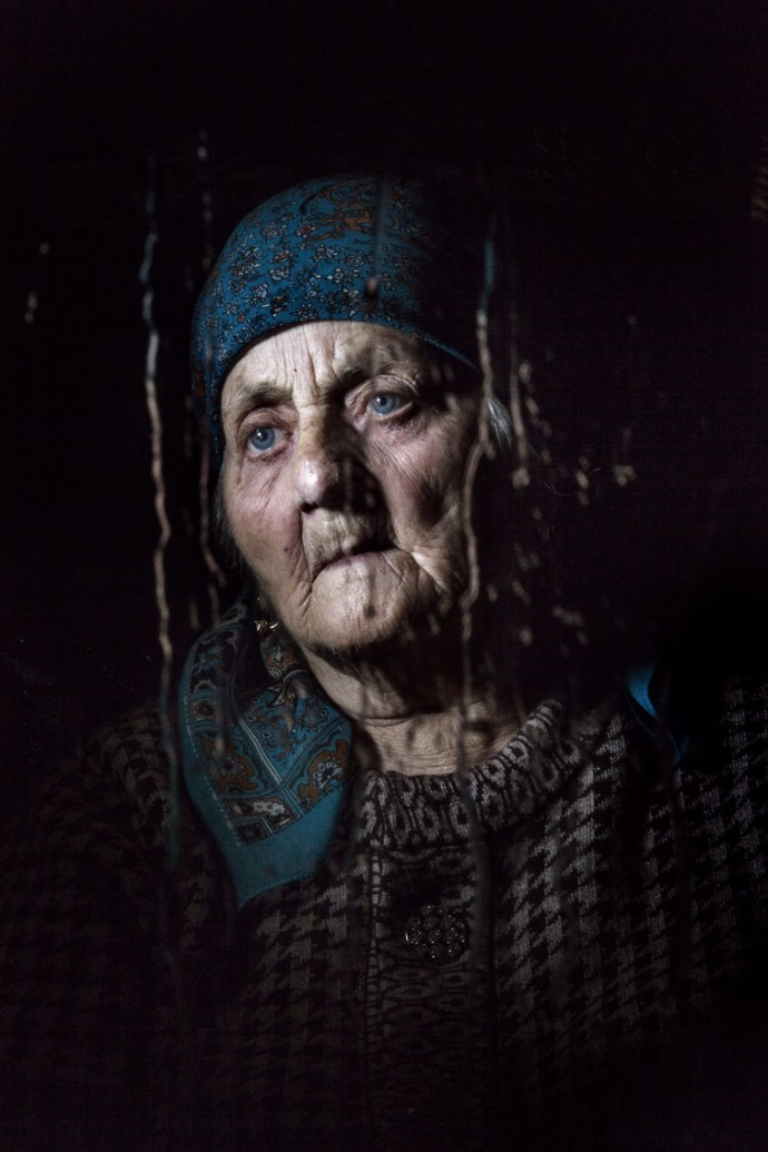 Chechen, Aina Akuieva, 91 years went through exile and upon arrival home lived happily in Grozny, but has lost her flat in bombardment of 1996, 1st Chechen war. She is seen in her only 6 sq meter property at the refugee compound in Chechnya.