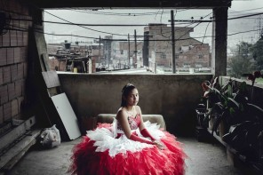 Laura Cristina Zarta poses in her Quinceanera Dress, at her parents' home in the southern suburb of Bogotá