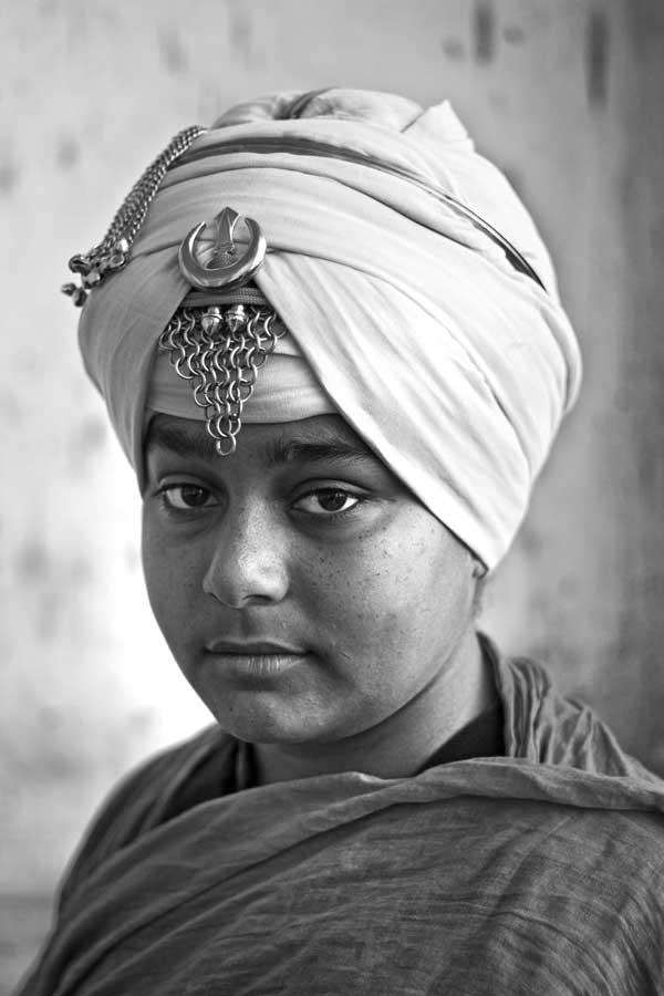 A cute Nihang Sikh boy at Hola Mohalla at Anandpur Sahib, Punjab, India