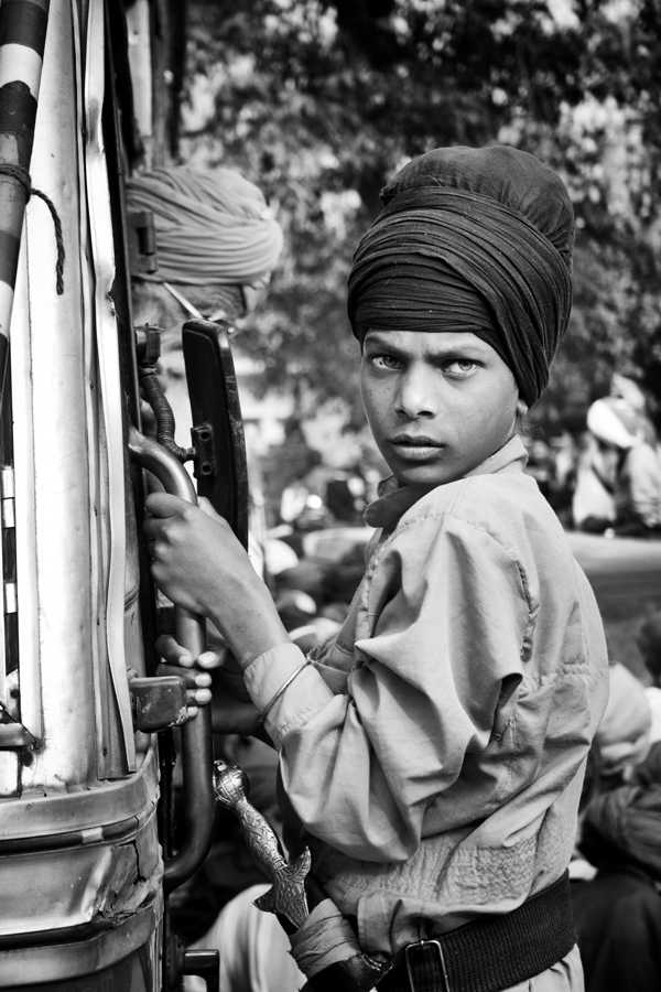 A young sikh boy with gritty looks at Hola Mohalla, Anandpur Sahib