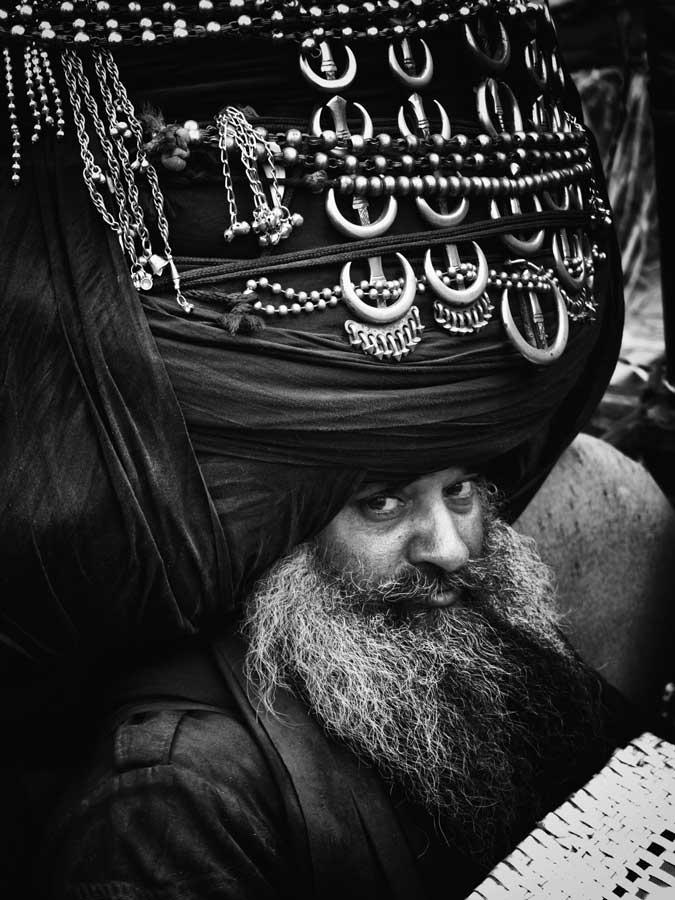 A Nihang Singh with Huge turban at Hola Mohalla, Anandpur Sahib, India