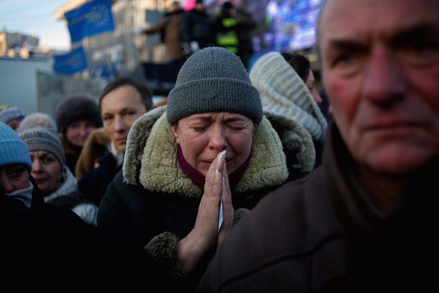 January 26, 2014 - Kiev, Ukraine: Thousands in Kiev mourn a protester shot dead during clashes with the Ukrainian riot police in Kiev, early in the week. An emotional crowd packed Saint Michael's Cathedral and spilled into a square outside to pay their last respects to 25-year-old Mikhail Zhiznevsky, with many waving Ukrainian flags with black ribbons. (Paulo Nunes dos Santos)