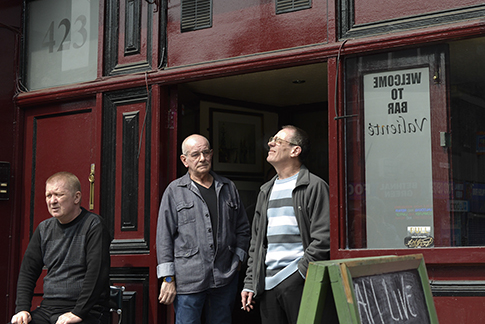 Disappearing Home-London East End's English community. 6. Men enjoy a sunny day at midday outside of a local pub in Bethnal Green on the 24th April 2015, London. The unemlpoyment rate of the East End is the highest of London.