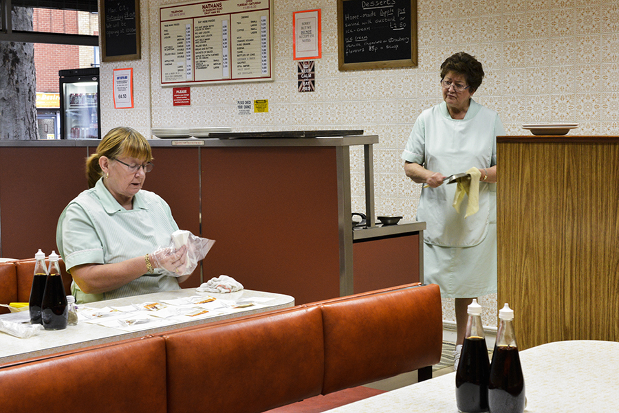 Disappearing Home-London-East End's English community. traditional pie and mash shop. 8. Shirley (left) and Chris (right, 3rd generation business owner) set up the Nathan's Eel 'n' Pie Shop before opening time on the 14th October 2014, London.