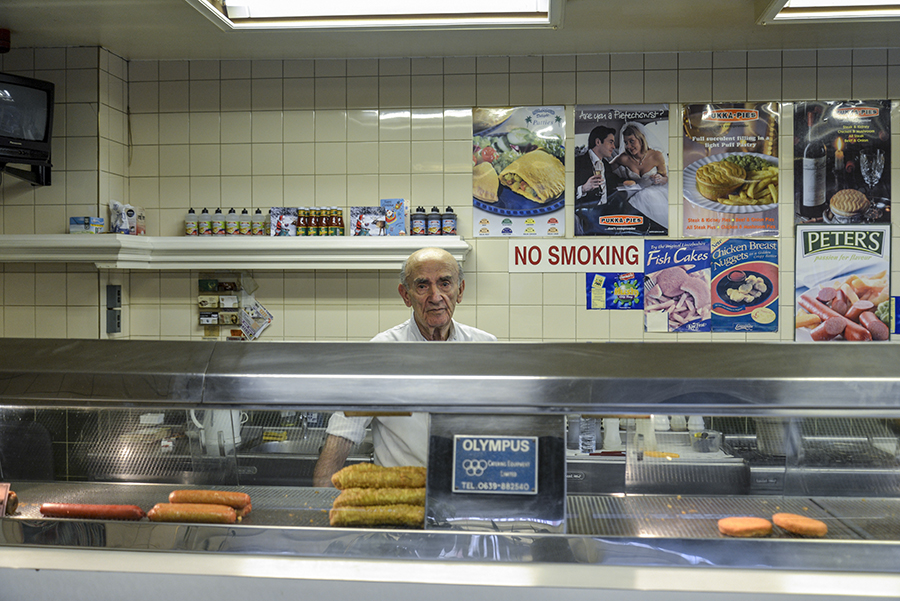 Disappearing Home-London East End's English community. 9. Nino, owner of the Nino's Capri Fish for 42 years, poses for a photograph inside his shop on the 28th December 2014, London.