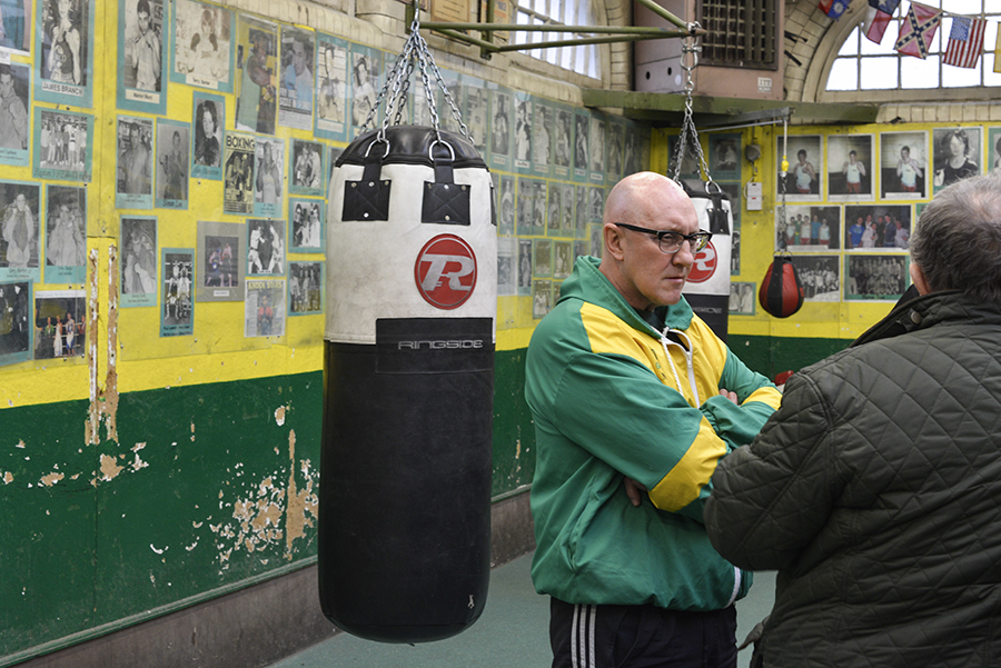 Disappearing Home-London East End's English community. 11. Gary Cooke (left) talks to the gym head coach Tony Burns at the Repton Boxing Club in Bethnal Green on the 19th March 2015, London.