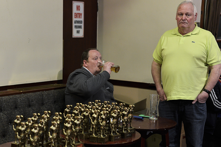Disappearing Home-London East End's English community. 12. Two men drink beer prior to the start of an amateur boxing bout at the East Ham Working Mens Club on the 10th April 2015, London.