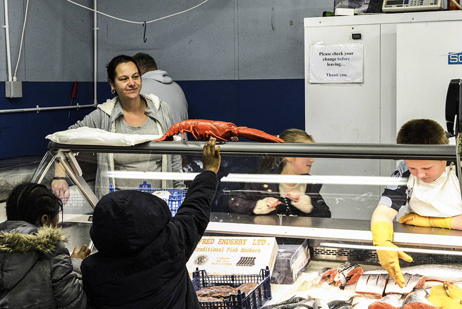 Disappearing Home-London East End's English community. 18. An English fishmongers family run business at the East Ham Market Hall, popular market with a mix of traditional East End shops and Asian stalls.
