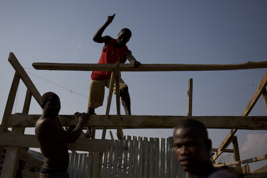 "Burundian university students, seeking shelter outside the US embassy in Bujumbura, build toilets and showers in the yard of a vacant building close by. The students moved to the area in early May because, they claim, the US authorities ensure their security, after their university was closed amid anti-government protests. The government closed the university at the end of April, citing ""insecurity""."