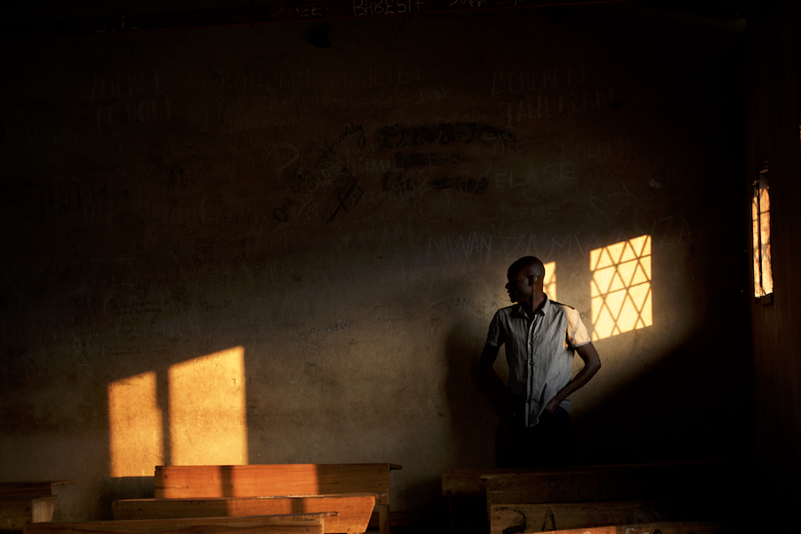 A staff member of the Burundian National Independent Electoral Commission prepare a room at a polling station in Cibitoke neighbourhood in Bujumbura, minutes before the start of the vote for the country's parliamentary elections., on June 29, 2015.