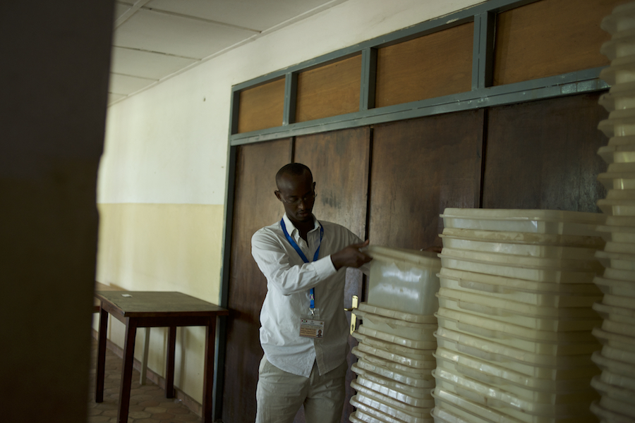 A member of Burundi's National Electoral Commission counts the ballot boxes at a warehouse being used to store electoral material for the upcoming parliamentary elections, in Niykabiga neighbourhood, Bujumbura, June 28th, 2015.