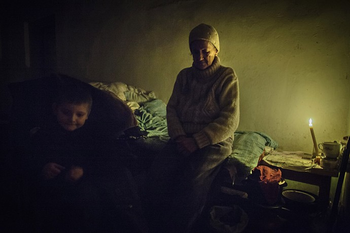 Elderly woman and her grandson in a bomb shelter in Donetsk, February 09 2015, Eastern Ukraine.