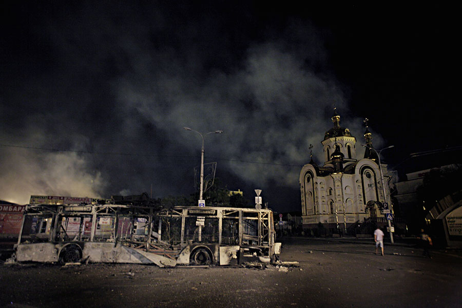 A trolley-bus, destroyed by the artillery strike seen on the railway station' square, center of Donetsk, which was subjected to artillery bombardment by the Ukrainian army, which has blocked the city, hoping to take it under control. August 30, 2014, Donetsk, Eastern Ukraine