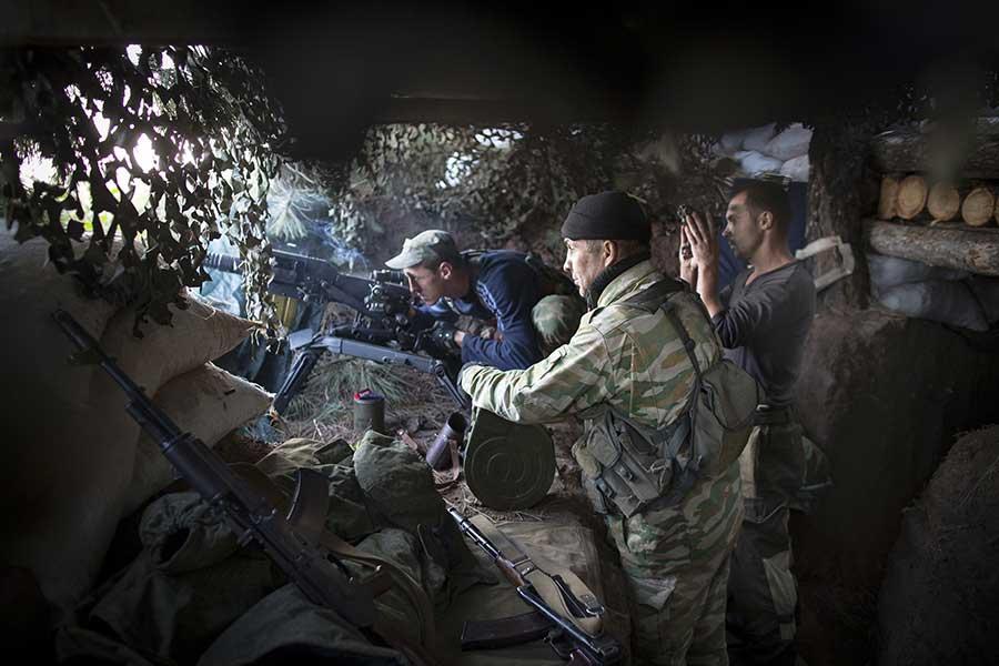 Separatist fighters checking their ammo on the frontline nearby Yasenovataya town, September 03 2015, Yasenovataya, East of Ukraine