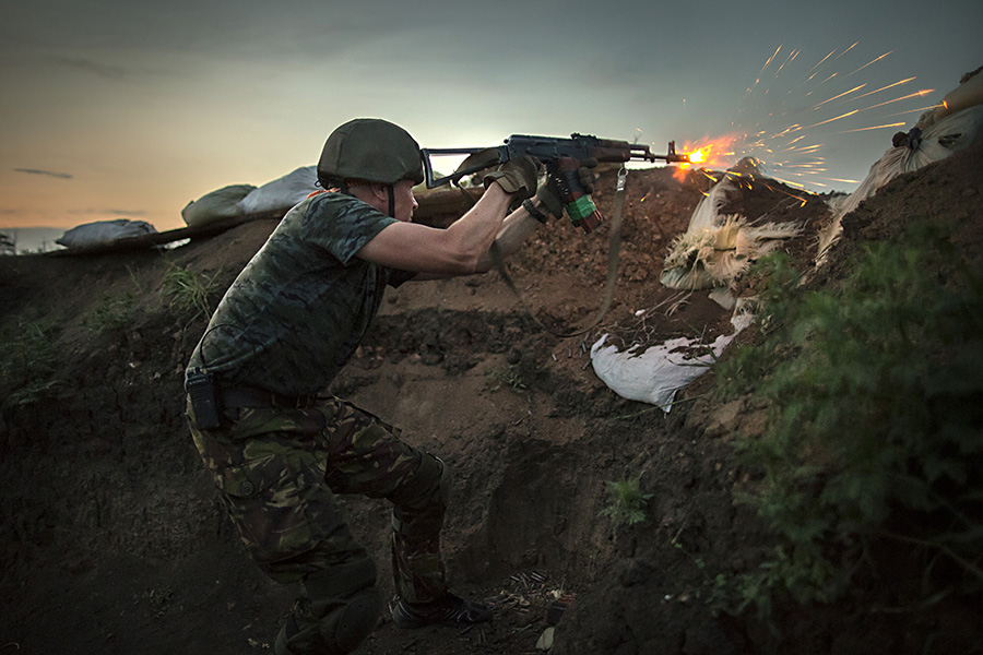 Ukrainian fighter engaged in battle with pro-Russian separatists on the frontline at Shirokino site, June 24th 2015, East of Ukraine, Photographer: Dmitri Beliakov