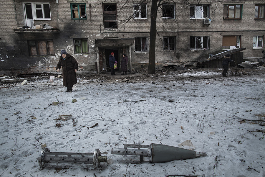 Remnants of cluster munition rocket lay in the yard of densely populated area after battle for Debaltsevo town, Eastern Ukraine, February 20 2015 Photographer: Dmitri Beliakov/ for The Sunday Times