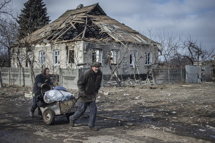 The battle for strategically important railway junction Debaltsevo was one of the fiercest of the entire war in Eastern Ukraine. Elderly pair on their way back to their house in Debaltsevo after picking up relief aid, Debaltsevo, Eastern Ukraine, February 20 2015 Photographer: Dmitri Beliakov/ for The Sunday Times