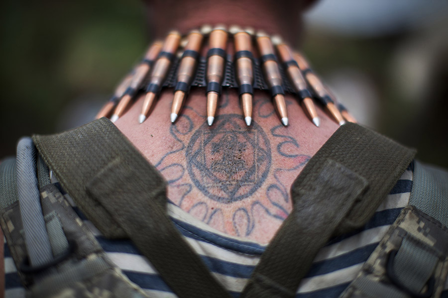 """""""Gunter"""", a fighter of Ukrainian volunteer National Guard battalion """"Donbas"""" with bullets around his neck, June 24th 2015, East of Ukraine"""