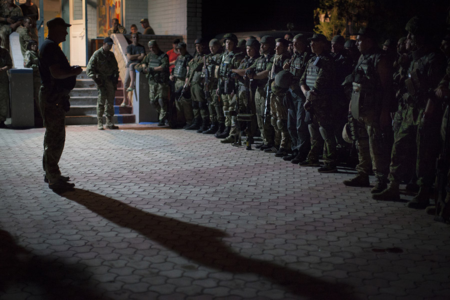 """Colonel """"Gal"""", the Commander of Ukrainian volunteer Special Force National Guard battalion """"Donbas"""" sending final instructions to his fighters before night raid to the frontline."""