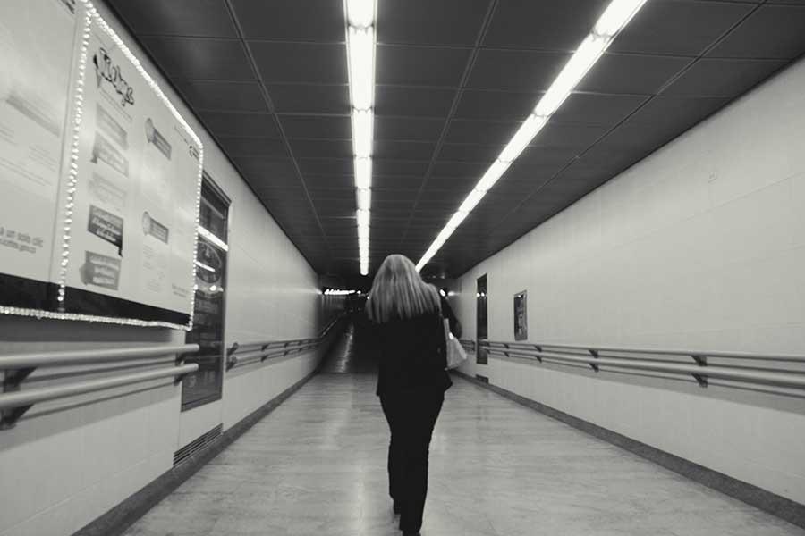 Women walking in the subterranean tunnel of public transportation (Transmilenio).