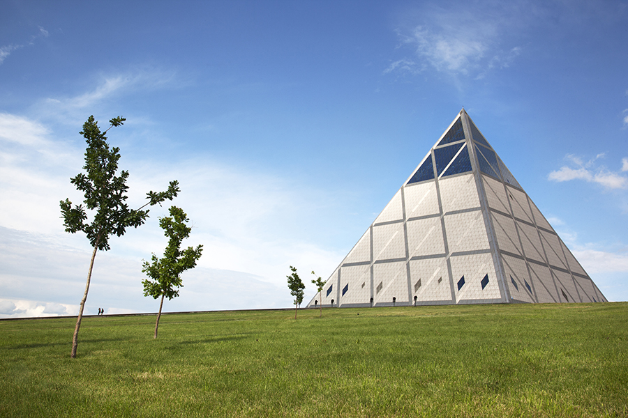 """Designed by famed British architect Sir Norman Foster, this $60 million, 250-foot-tall glass pyramid in the world's youngest capital city, stands in isolation in the vast grasslands of the Kazakh steppe. Formerly the centre of the Soviet 'Virgin Lands Campaign' of the 1950's, the town of Akmola has been transformed into the futuristic show city of Astana (""""capital"""")."""
