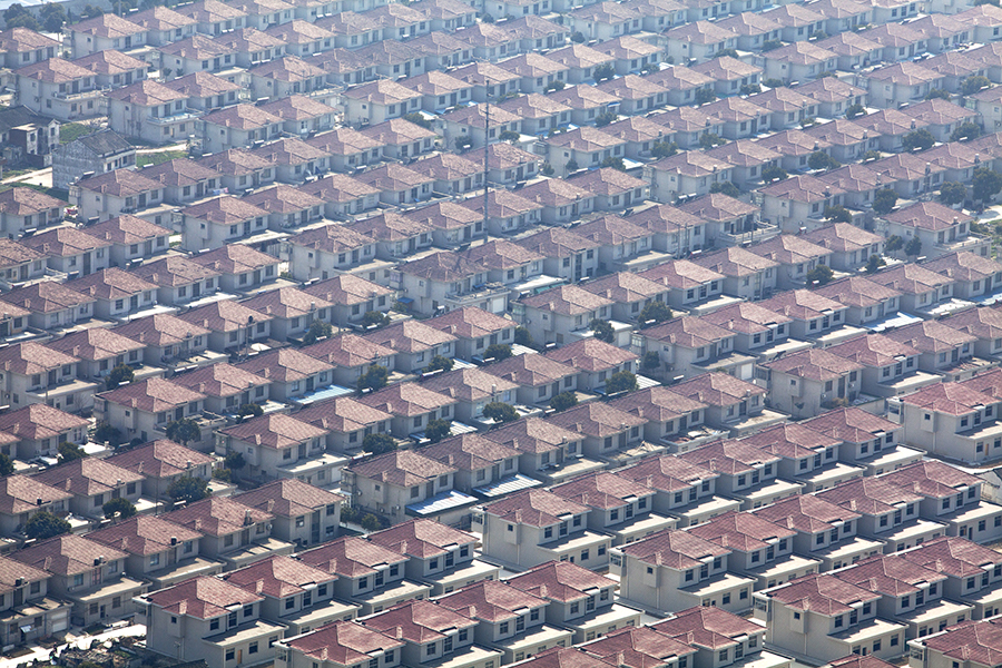 Standardized villas packed side-by-side form the two thousand-member socialist collective of Huaxi Village in rural Eastern China.