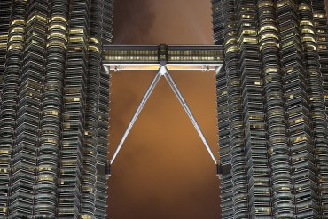 Currently the world's tallest twin buildings, the Petronas Tower skyscrapers also boast the world's highest two-story bridge. architect: Cesar Pelli