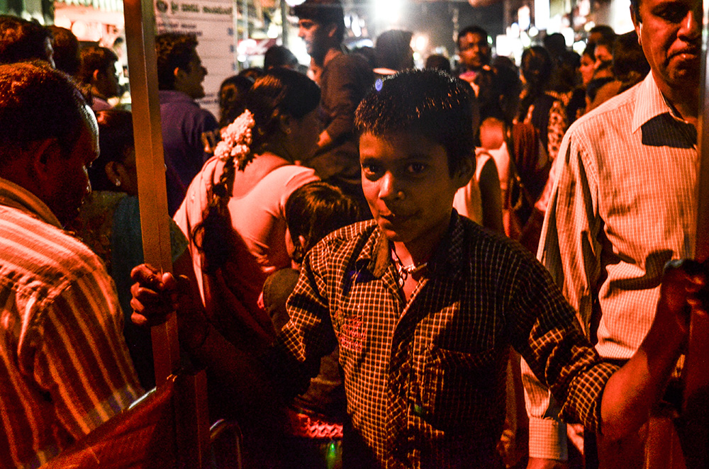 A young boy pushes a food cart