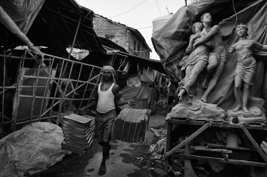 The muddy, narrow by-lane of Banamali Sarkar Street, the nerve centre of Kumartuli, is flanked by congested workshops.