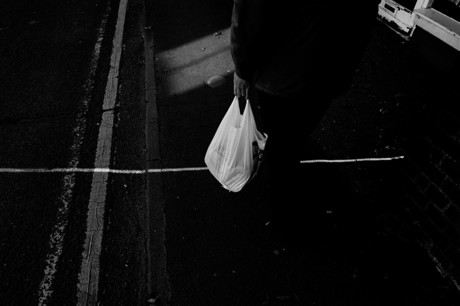 Navigating the pavement on the journey home, each step, a step into blackness.