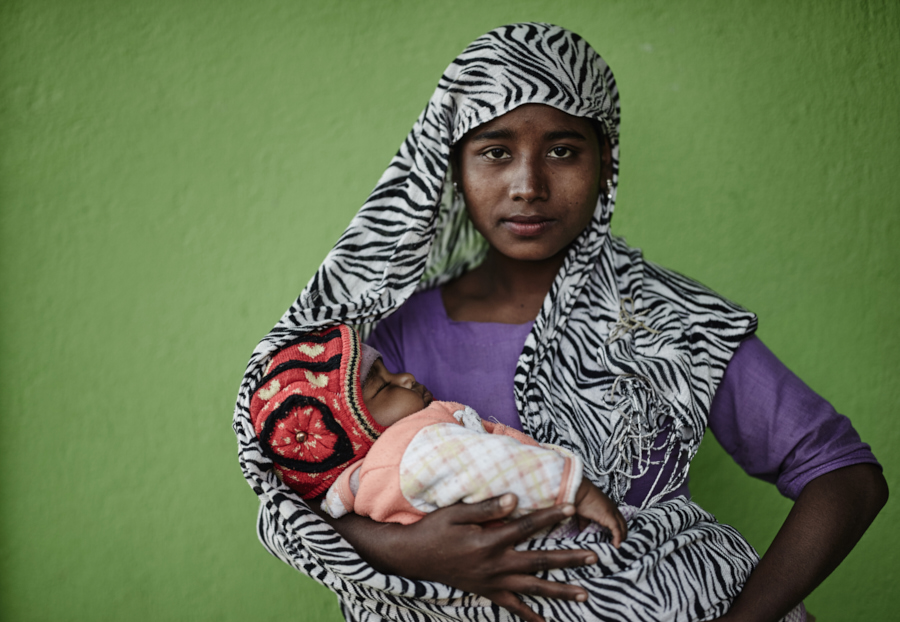 Young mother with her baby. They belong to the Rohingya commnity in Mynamar and live as illegal refugees in Kathmandu.