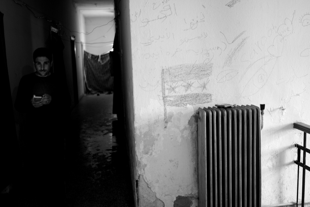 A refugee walks in the hall of an abandoned building in Idomeni old train station at Idomeni refugee camp. *** Local Caption ***