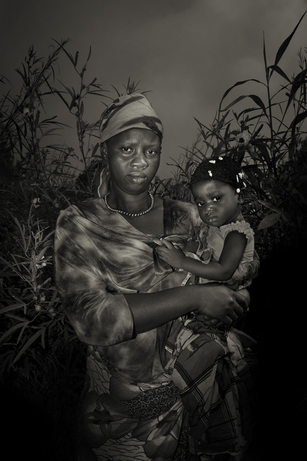 Sankoh Isatu, 30 with her daughter Kaoiatu, 2. They contracted ebola from Sankoh husband that got sick in Kenema, while working as well digger.