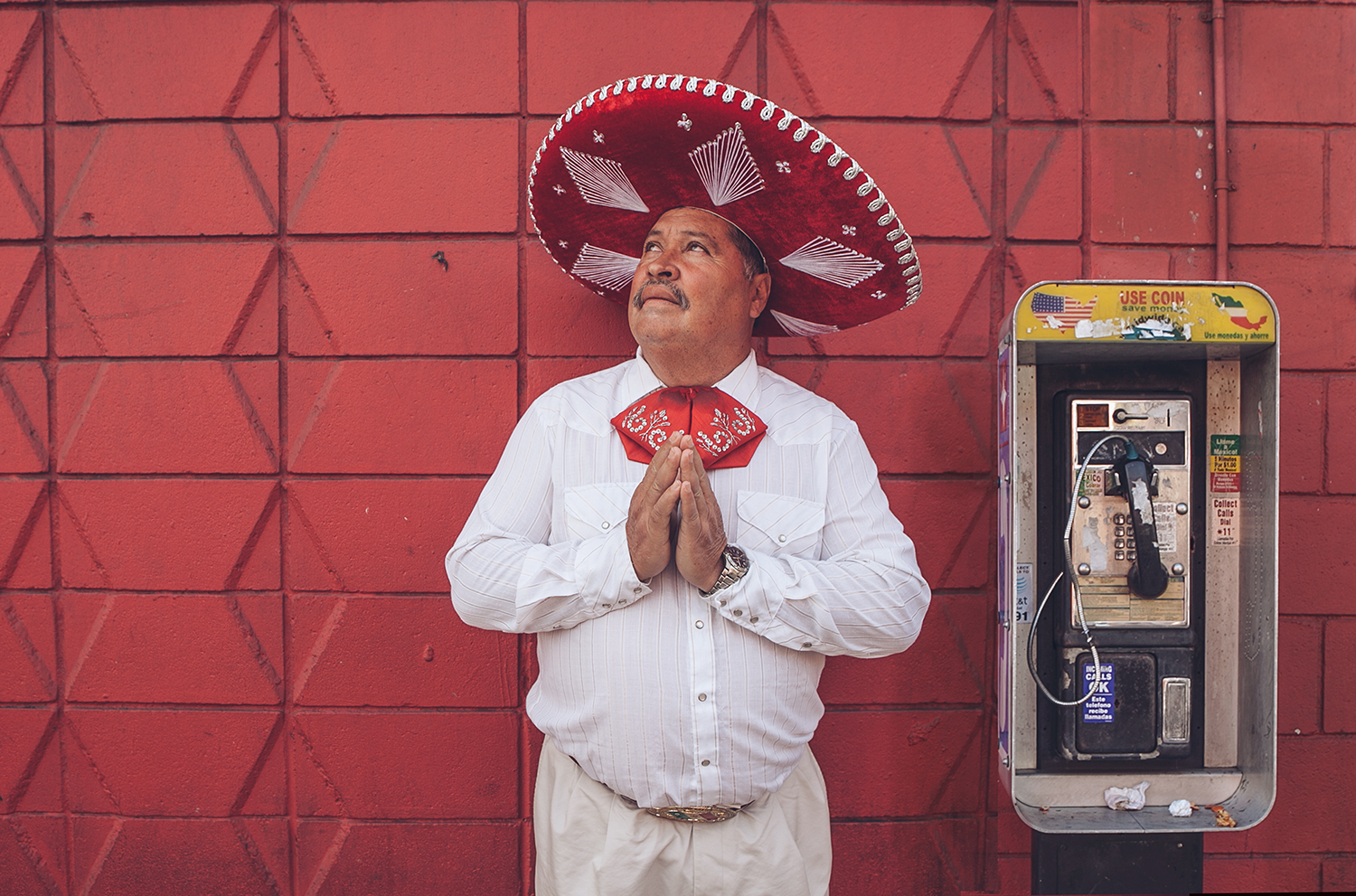 I was strolling along China town, when I noticed this man dressed in traditional mariachi attire. I approached him and asked where he was coming from. He said that he was a singer at church, I was surprised because I assumed it would've been some kind of Mexican restaurant where he maybe plays or sings. The man was such a gentleman, after making a this image, he wished me luck with blessings and went on his way.