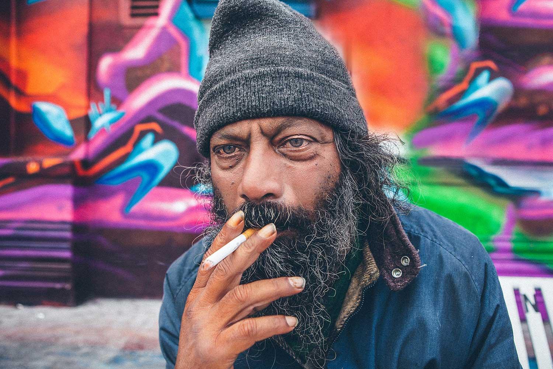 Man smoking cigarette in Venice beach 2014