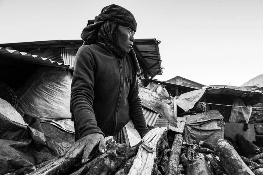 A resident of the village of Barpak doing everyday work.