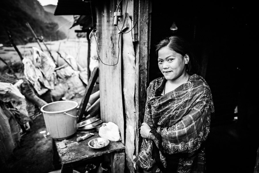 A resident of the village of Baluwa, Gorkha District, in front of a temporary shelter in which she is living with her parents, two sisters and grandfather. Daughter of Suk Bahadur Gurung