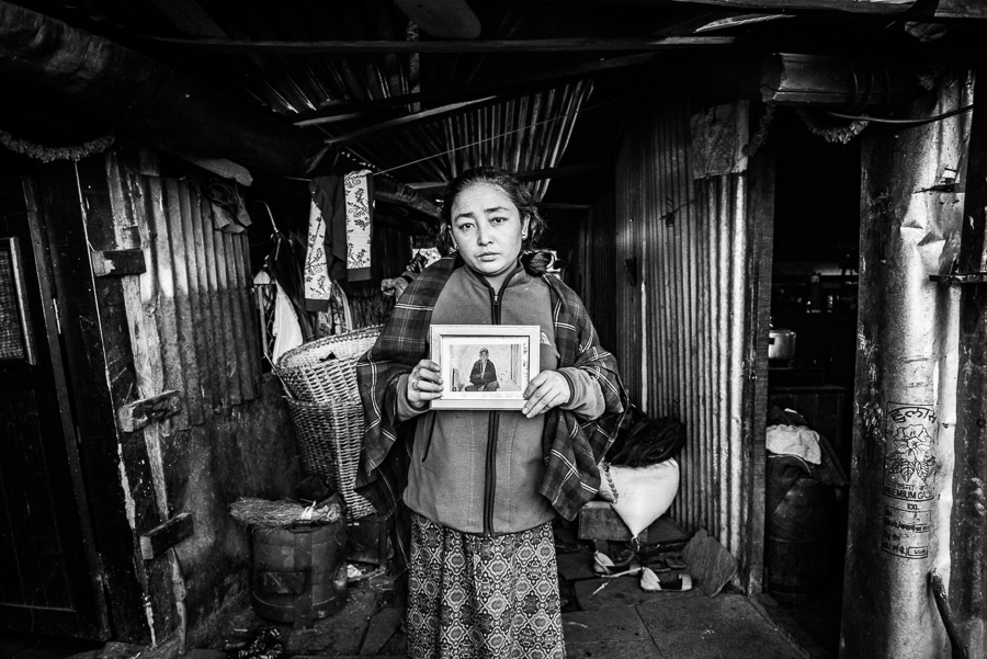 Ram Maya Ghale resident of Barpak next to her home; she lost a member of her family in the 2015 earthquake. Barpak, Gorkha District.