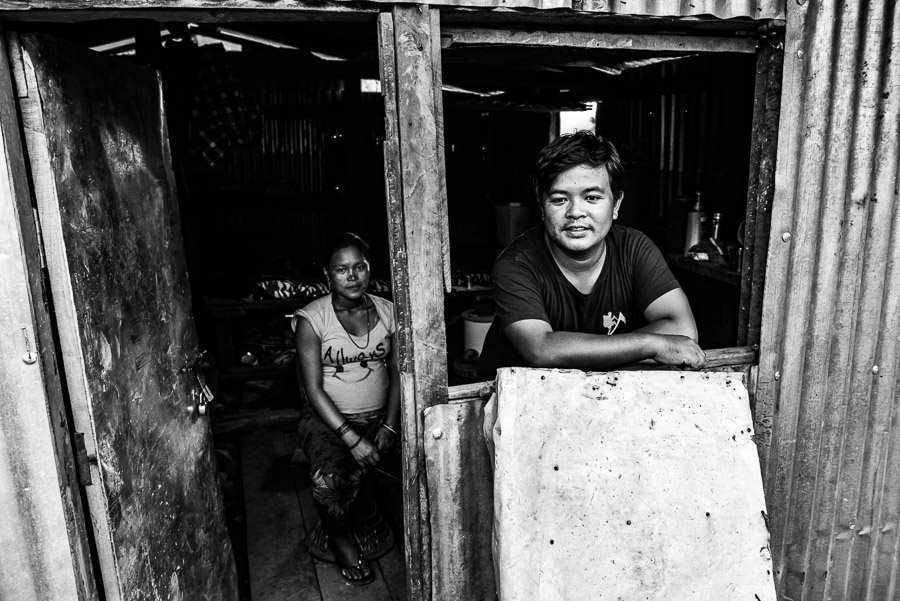 A family living in a temporary shelter in the village of Baluwa, in Gorkha District.