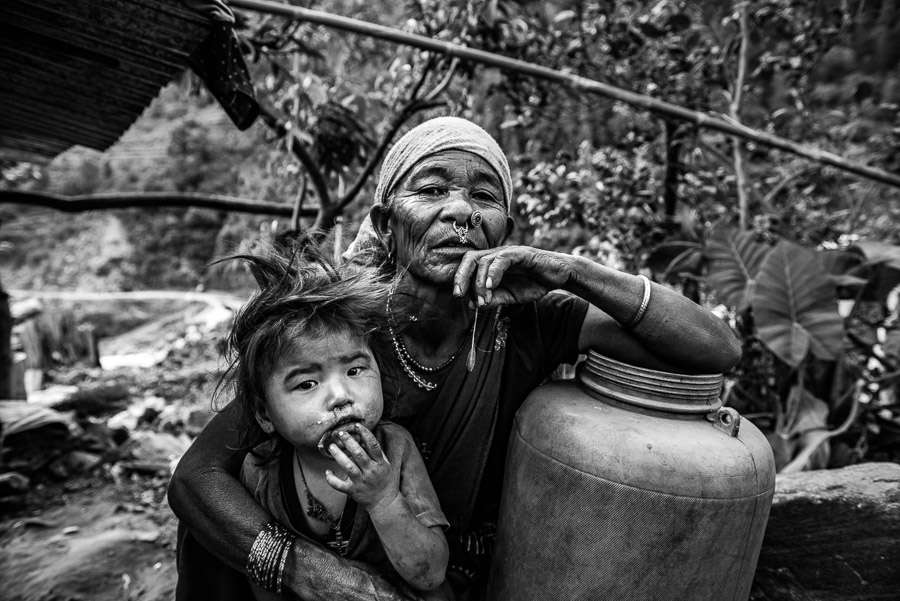 Maldhani Gurung a 70-year-old woman with her granddaughter in the village of Baluwa, Gorkha District, near the epicentre of the 2015 earthquake.
