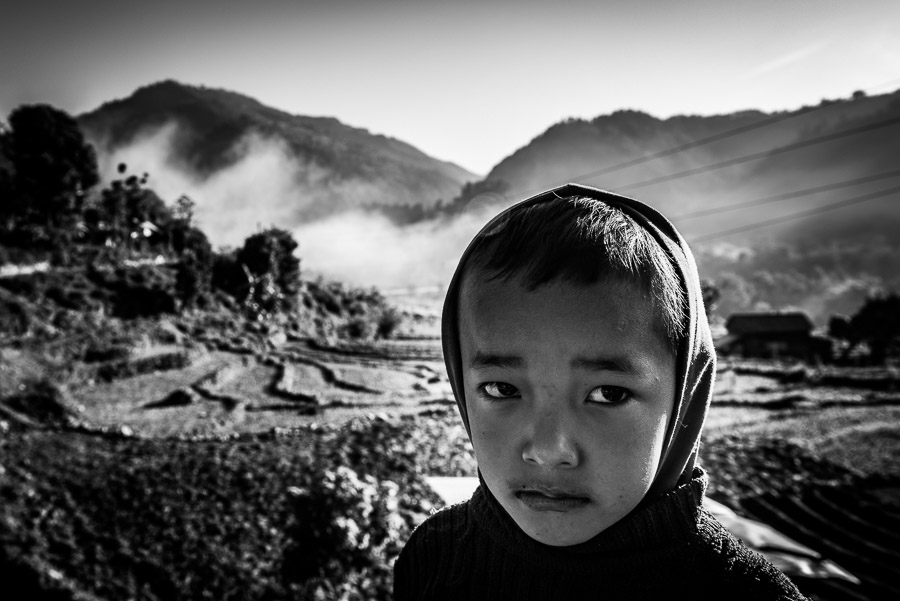 A boy against a background of the Himalayas in Baluwa, near the epicentre of the earthquake of 25 April 2015.