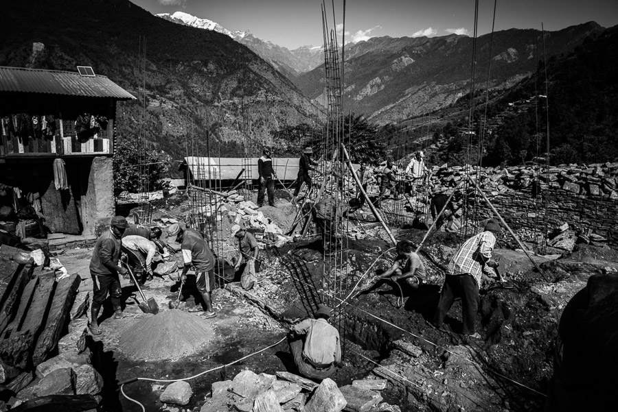 Men rebuilding houses destroyed by the earthquake of April 2015. Mandre, Gorkha District, near the epicentre