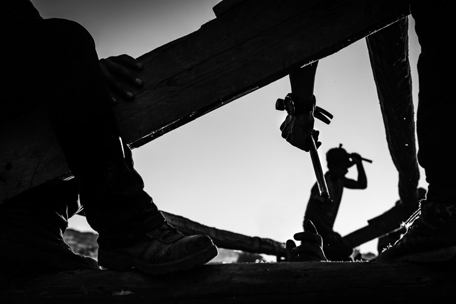 Workers rebuilding houses in Barpak, Gorkha District, in the epicentre Fof the 2015 earthquake which almost destroyed the entire village.