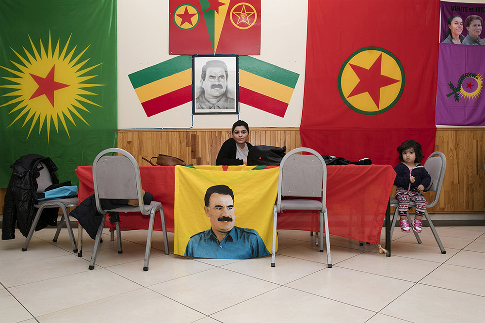 Community center of the Kurds. The walls of the building are covered with images of the improsond political leader Özalan and (deceased) Kurdish soldiers, who have received the status of martyr for the community.