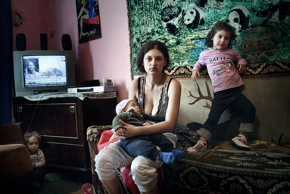 Dano Suzana, mother of 3 (Harco David Raul, Dano, Denisa Izabela and Harco Renata Raluca) seen in her one room apartment on Horea Street in Baia Mare, September 20, 2011. Following on his pre-electoral racist promises to segregate the Roma, Catalin Chereches, the mayor of Baia Mare, a city located in the Northern part of Romania, decided to build a wall around a complex of social houses, mostly inhabited by Romanian citizens of Roma origins. The initiative was justified in mayor's eyes, by the bad behavior of the Roma kids who allegedly throw rocks at the passing by cars and occasional traffic accidents reported in the area. The plan also includes adding video cameras and a police station to monitor the situation in the complex.