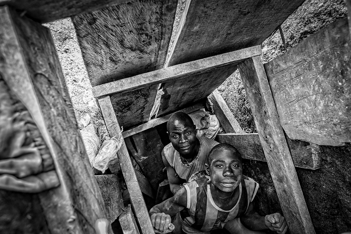 Miners inside a tunnel.